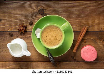 cup of coffee and ingredients at wooden background, top view