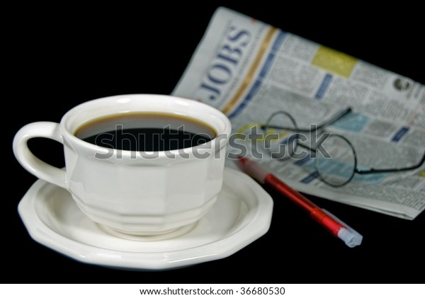 cup of coffee with the job classifieds