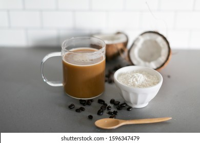 Cup of coffee with keto coconut creamer in white modern kitchen