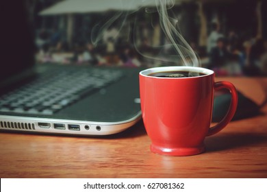 A cup of coffee and laptop
