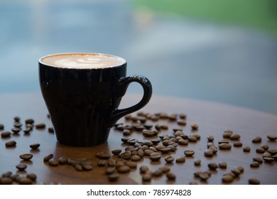 A cup of coffee, late art or morning coffee with the coffee bean