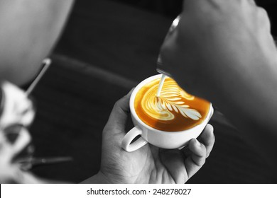 cup of coffee latte art in black and white