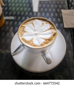 Cup of coffee with Latte art on the table
