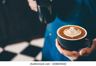 Cup of coffee latte art with coffee shop.