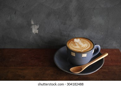 cup of coffee latte art in coffee shop
