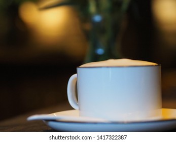 A cup of coffee latte in cozy cafe,China