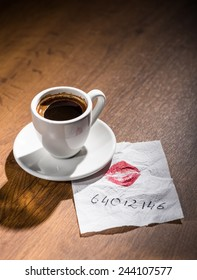 Cup of coffee and a lipstick note