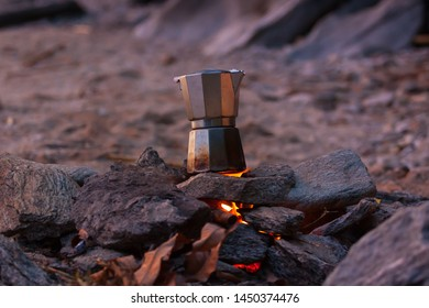 Cup of Coffee made with percolator on a fire (on the Lake Malawi Beach)