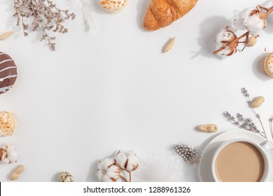 A cup of coffee with milk. Composition with lavender, nuts on a light background.