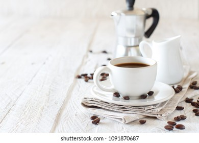 Cup of coffee with milk on a rustic wooden background close up