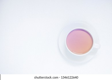 Cup of coffee with milk on a white background, top view, toned.