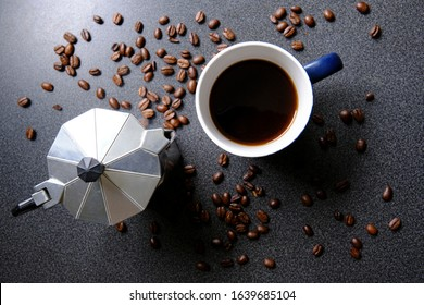 Cup of coffee, moka pot and coffee beans
