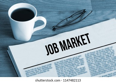 A cup of coffee and a newspaper job market