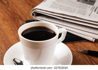 cup of coffee and the newspaper and pause at work