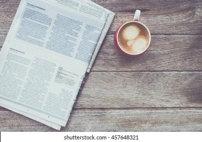 cup of coffee with Newspaper in coffee shop.