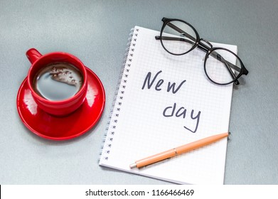 Cup of coffee, a notepad, glasses and a yellow pen on your desktop. Concept motivation and success. Concept is a new day. Concept plans and planning.