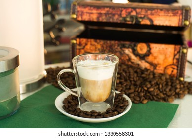 cup of coffee on the background of the chest and coffee beans on the table