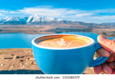 A cup of coffee on the background of snowy mountains