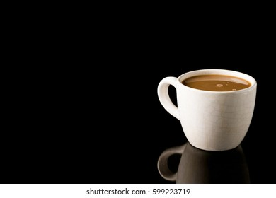 Cup of coffee on black background. Free space for text