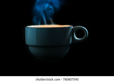 Cup of coffee on black background,abstract color smoke