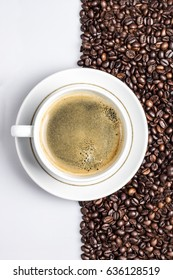 Cup of coffee on a coffee grains