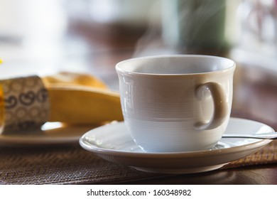 Cup of coffee on a morning food tables.