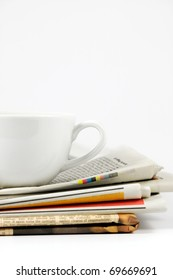 Cup of coffee on newspaper