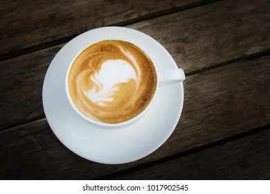 A cup of coffee on the old wooden table