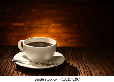 Cup of coffee  on old wooden background