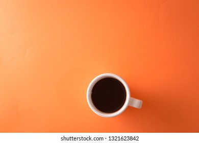 cup of coffee on orange background