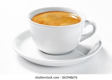 A cup of coffee on a plate isolated on white background. Double Americano