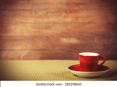 Cup of a coffee on polka dot cover. Photo in old color image style.