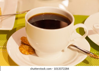 a cup of coffee on a table in a cafe