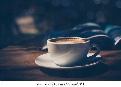 cup of coffee  on table in cafe in dark tone and vintage