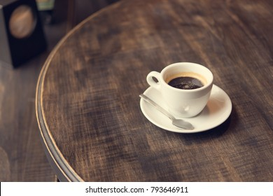 cup of coffee on table in cafe shop. fresh drink since morning background