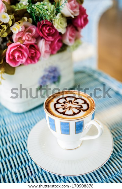 Cup of coffee on table in the morning