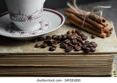 cup of coffee on vintage books coffee beans on a wooden table. Free space for text. copy space