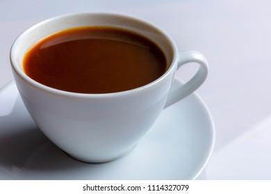 A cup of coffee on a white background