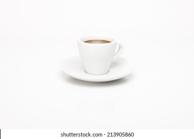 Cup of coffee on white background with reflection