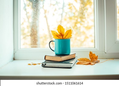 cup of coffee on the windowsill, autumn