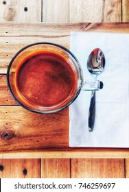 A Cup of coffee on wood background