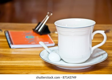 Cup of coffee on a wood background.