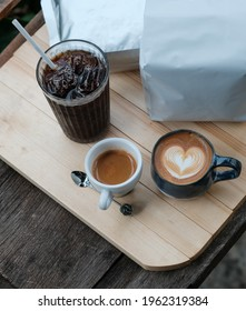Cup of coffee on wood table background