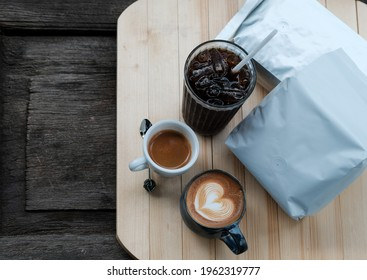 Cup of coffee on wood table background, copy space