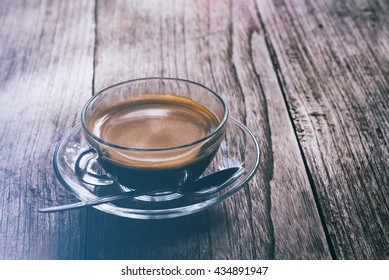 Cup of coffee on the wood table that suitable for background,backdrop,wallpaper,display and artwork design.