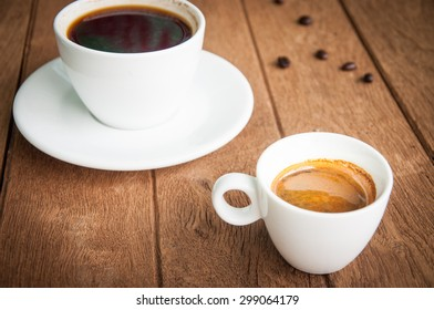 Cup coffee on wooden background