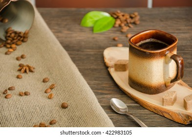 Cup of coffee on a wooden stand