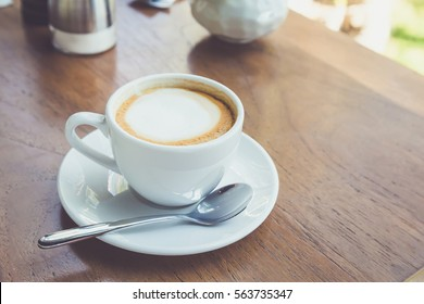 A cup of coffee on the wooden table
