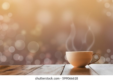 Cup of coffee on the wooden table abstract background bokeh circles, shallow depth of field