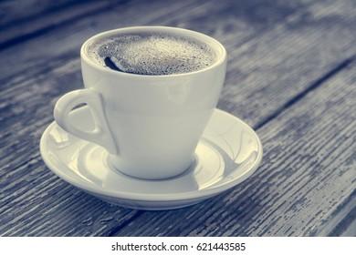 Cup of coffee on wooden table. Coffee break, breakfast.